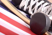 Puck, skates and hockey stick of the American flag — Stock Photo