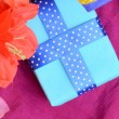Sweet color flowers from mulberry paper whith holiday gift box — Stock Photo #76129403