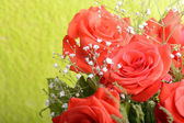 Bouquet of blossoming dark red roses in vase, close up flower — Stock Photo