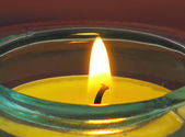 Candle in a glass candlestick — Stock Photo