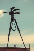 TV camera on tripod, vintage style — Stock Photo