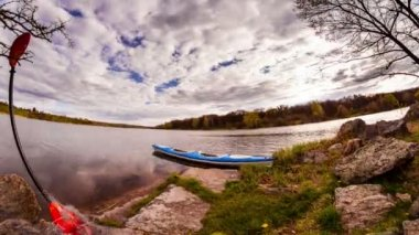 Kayak on river and running clouds. Time Lapse. — Stock Video