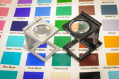 Twin magnifier loupes on color chart. — Stock Photo