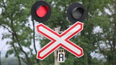Red traffic light on railroad — Stock Video