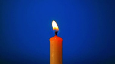 Candle close-up on blue — Wideo stockowe
