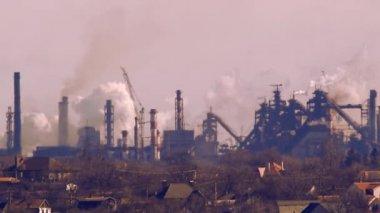 Buildings against metallurgic plant — Stock Video