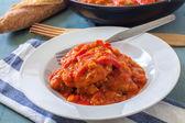Tuna on sauce — Stock Photo