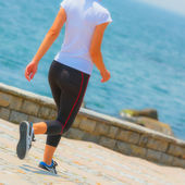 Runner girl - athlete running at seaside, woman fitness — Fotografia Stock