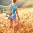 Woman in golden wheat field — Stock Photo #52758423
