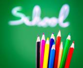 Colorful pencils on chalkboard background — Stock Photo