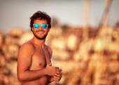 Handsome guy on the beach — Stock Photo