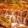 Beautiful waterfall in autumn park — Stock Photo #54587303