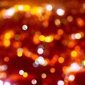 Christmas background of blur bokeh lights — Stock Photo