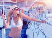 Attractive woman on sailboat — Stock Photo