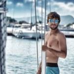 Sexy man on sailboat — Stock Photo #56264945