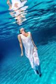 Beautiful female underwater — Stock Photo
