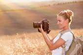 Happy photographer enjoying nature — Stock Photo