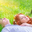 Young lovers resting outdoors — Stock Photo #56860071