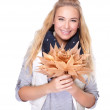 Happy woman with dry leaves — Stockfoto #56862805