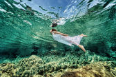 Swimming in transparent sea — Stock Photo