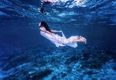 Swimming in beautiful blue sea — Stock Photo