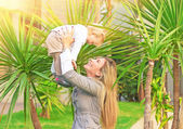 Cheerful mother playing with baby — Stock Photo