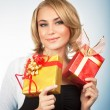 Pretty woman with Christmas gifts — Stock Photo #59560031