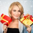 Pretty woman with Christmas gifts — Stock Photo #59560093