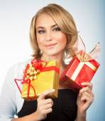 Pretty woman with Christmas gifts — Stock Photo