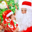 Receive present from Santa Claus — Stock Photo #60093935