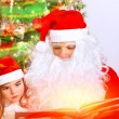 Santa Claus with cute granddaughter — Stock Photo #60093993