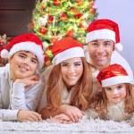 Happy family in Christmas eve — Stock Photo #60563749