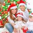 Happy family celebrating Christmas — Stock Photo #60692991