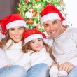 Happy family on Christmas eve — Stock Photo #60693007