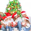 Happy family in Christmas eve — Stock Photo #60693009