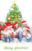 Happy family in Christmas eve — Stock Photo