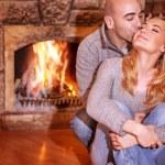 Loving couple near fireplace — Stock Photo #61040587