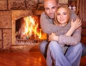 Gentle couple near fireplace — Stock Photo