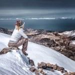 Sitting on the top of mountain — Stockfoto #61827201