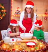 Happy family cooking for Christmas — Stock Photo