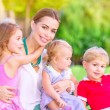 Happy mother with babies — Stock Photo #68606169