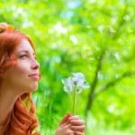 Happy woman with dandelions — Stock Photo #71248483