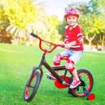 Cute little boy riding a bike — Stock Photo #73886129