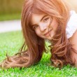 Cute girl on green grass — Stock Photo #73886927