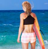 Sportive woman on the beach — Stock Photo