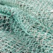 Closeup of green netting — Stock Photo #53656409