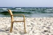 A chair on an empty beach — Foto de Stock