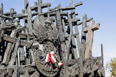 Monument with crosses and the emblem of Poland — Stock Photo
