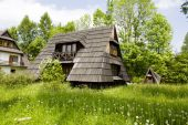 Small wooden building with the sloping roofs — Foto de Stock