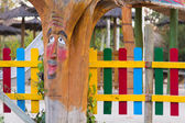Tree trunk childishly decorated with a face in a park — Stock Photo